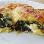 Spinach with potato in oven